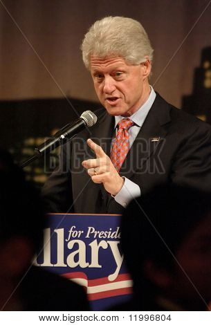 FLUSHING, NY - MARCH 27: Former US President Bill Clinton gestures as he stumps for his wife, Hillary, at Korea Village Banquet Hall on March 27, 2007 in Flushing, NY.