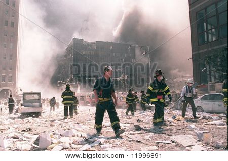NEW YORK - SEPTEMBER 11:  New York City firefighters work near the area known as Ground Zero after the collapse of the Twin Towers September 11, 2001 in New York City.