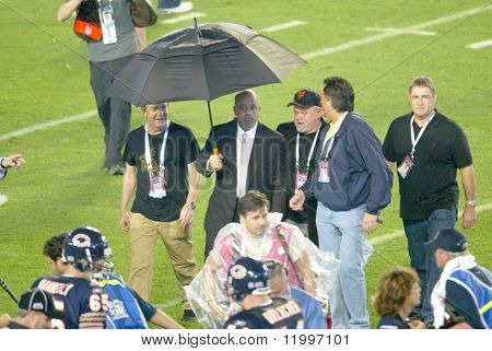 MIAMI - FEB 4: Singer Billy Joel (C) walks off the field after performing at Super Bowl XLI between the Indianapolis Colts and Chicago Bears at Dolphins Stadium on February 4, 2007 in Miami, Florida.