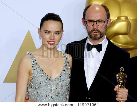 James Gay-Rees and Daisy Ridley at the 88th Annual Academy Awards - Press Room held at the Loews Hollywood Hotel in Hollywood, USA on February 28, 2016.