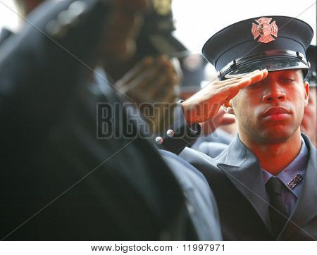 JAMAICA, NY - OCTOBER 21:  An unidentified NYC firefighter salutes as he attends a memorial service for Firefighter James O'Shea of Ladder Company 127 on October 21, 2004 in Jamaica, New York.