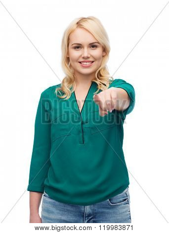 female, gender, gesture, plus size and people concept - smiling young woman in shirt and jeans pointing finger on you