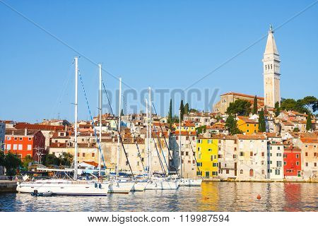 Morning view on sailboat harbor in Rovinj with many moored sail boats and yachts.