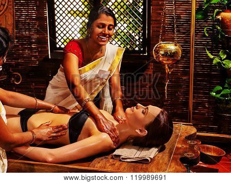 Young woman having neck Ayurveda spa treatment massage.