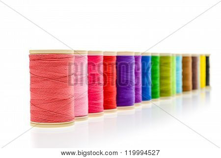 Different Color Sewing Threads On A Roll.