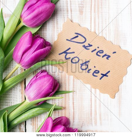 Women's day card and a bouquet of beautiful tulips