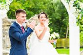 Couple Getting Married at an Outdoor Wedding Ceremony. poster