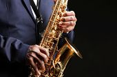 African American jazz musician playing the saxophone, closeup poster
