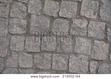 Road paved with small rectangular granite setts