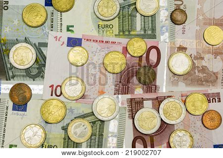 Euro banknotes and coins. Money as a background.