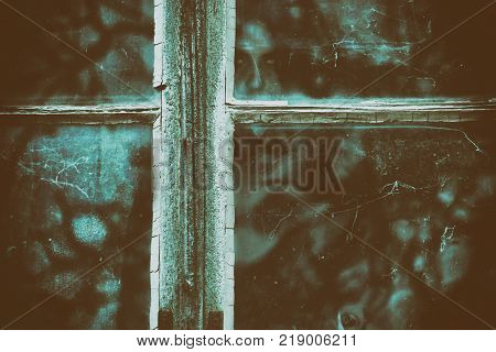 Horror scene of a scary woman behind the dirty window glass