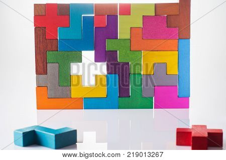 Abstract Background. Background with different colorful shapes wooden blocks. Geometric shapes in different colors. Concept of creative logical thinking or problem solving. Decision making process.