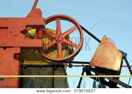 Crank counter weight pitman arm and revolving flywheel of oil pumpjack