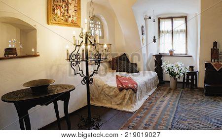 Bran, Romania - September 7, 2017: One of the bedrooms of the Bran or Dracula Castle in Transylvania, Romania.