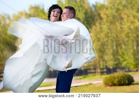 Belarus Gomel September 29 2017 Wedding Feast.The bridegroom holds the bride in her arms.The bride and groom are happy
