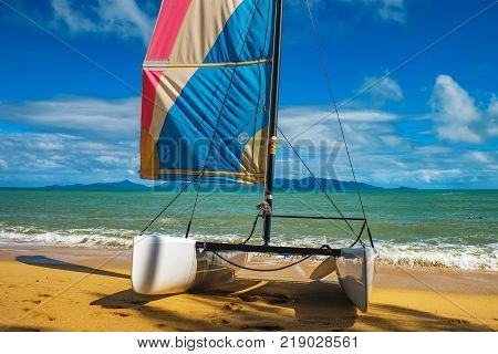 Koh Samui, Thailand - December 24, 2015: Pre-travel preparations at Maenam beach Koh Samui Thailand. Catamaran sailboat on a beautiful summer day.