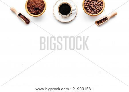 Coffee concept. Roasted beans, ground coffee, cup of espresso on white background top view.