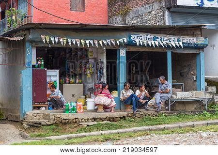 POKHARA NEPAL - October 02 2013: Local people on the street of Pokhara. Unidentified people walking through the colorful streets of Pokhara.