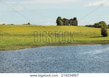ruins of a stone building on the shores of the River Shannon, Ireland