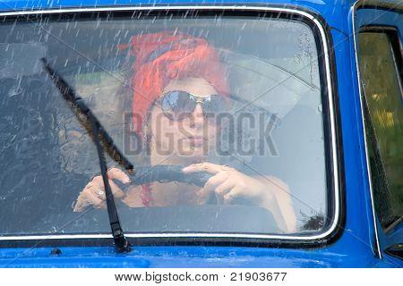 Vintage Girl In Car Under Rain