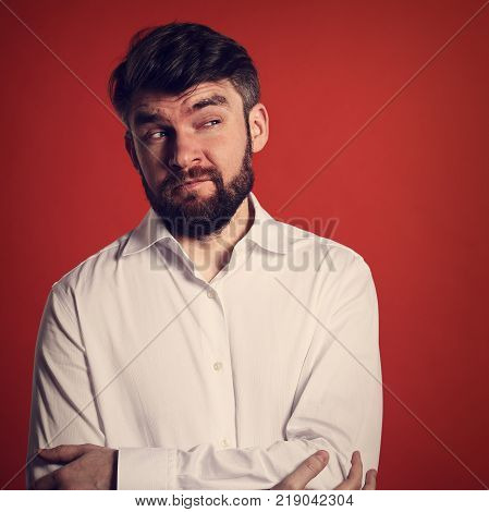 Happy Excited Bearded Business Man In White Shirt Pointing Down The Finger On Red Background. Closeu