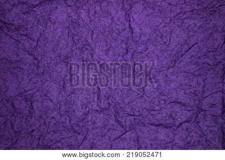ABSTRACT RANDOM BACKGROUND OF CREASED CRUMPLED PURPLE TISSUE PAPER