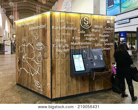 Stuttgart, Germany - December 09, 2017: A Vending machine is offering fair produced local food and drinks in the main station of Stuttgart in Germany.