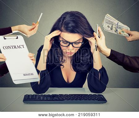 Desperate woman leaning on a desk. Stressed girl overwhelmed by things errands should be done. Human emotions