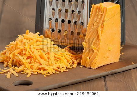 Grated Red Leicester Cheese. Grater. Cooking Ingredient