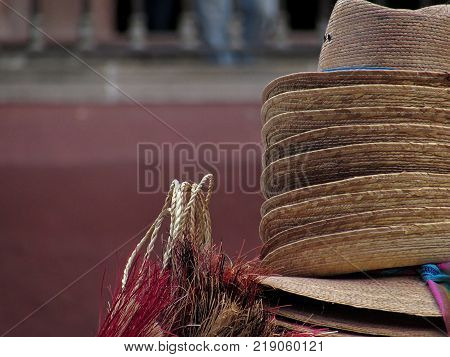 Close-up shot with depth of field of traditional mexican hand-crafted hats and other items in San Miguel de Allende, Mexico