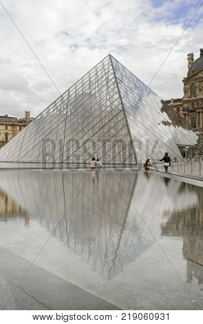 Paris France - September 10 2017: Tourists walk in courtyard of the Musee du Louvre.