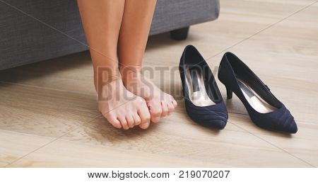 Woman suffer from toe pain after wearing high heel