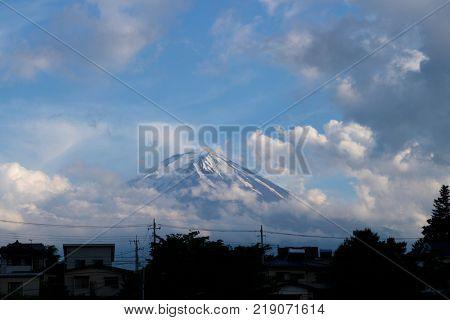 Kawaguchio - Japan, June 14, 2017: Mount Fuji at twilight seen from Kawaguchio in Fuji Five Lake region
