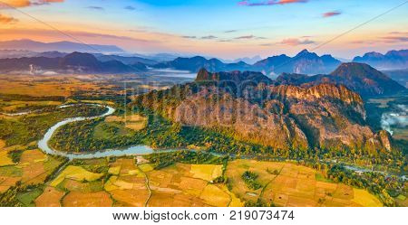 Aerial view of the fields, river and mountain. Beautiful landscape panorama. Vang Vieng. Laos.