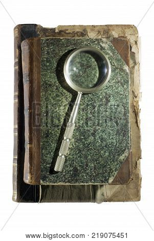 Two ancient shabby books and a magnifying glass for reading isolated on each other