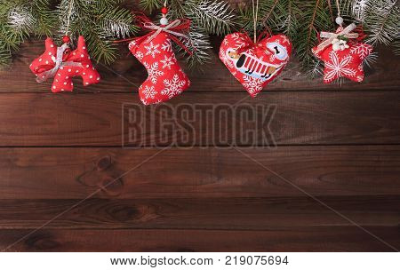 Christmas textile decoration on a wooden background.Greeting card.