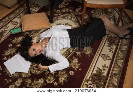 Strangled Beautiful Business Woman Lies On The Floor.