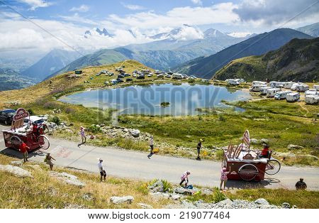 Col de la Croix de Fer France - 25 July 2015: Banette caravan driving on the road to the Col de la Croix de Fer in Alps during the stage 20 of Le Tour de France 2015. Banette is the leading brand for the artisan bread in France.