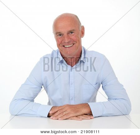 Portrait of smiling senior man on white background