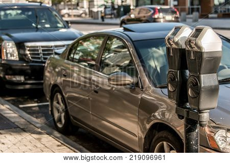 Boston MA USA 04.09.2017 Boston USA Massachusetts - Parking meter at paid parking in the street with cars behind it