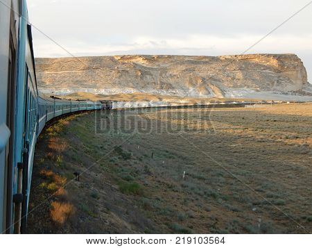 Arid steppe landscape from the window of a train poster