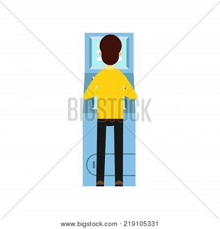 Man getting money from cash machine ATM . Cartoon male character dressed in yellow sweater and black pants, back view. Banking theme. Vector illustration in flat style isolated on white background.