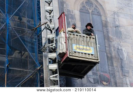 Prague Czech Republic -5 December 2017: Workmen restoring ancient building Prague
