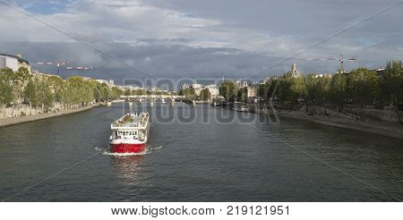Paris cityscape with Seine River at cloudy day.