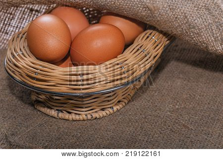 Easter composition. A few eggs in the straw of basket straw closeup