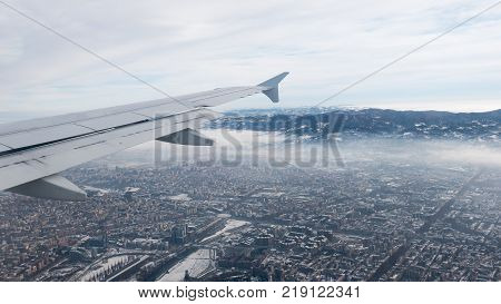 Turin aerial view. Torino cityscape from above Italy. Winter fog and clouds on the skylline. Smog and air pollution.