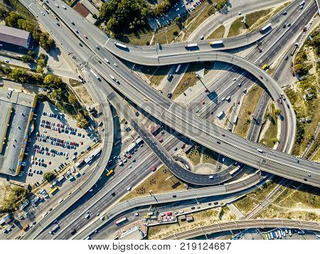 Roadway system in Kyiv. There are many cars and trucks on the roads. Top view aerial photo. Horizontal.