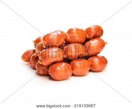 Strings of mini chorizo sausages isolated on white