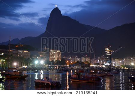 Rio de Janeiro Brazil - dezembro 19 2017: View of botafogo cove with Christ Redeemer in the background at dusk