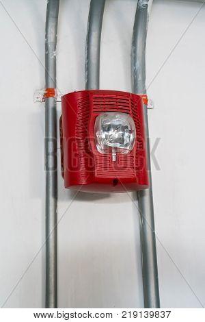 Red Fire alarm lighting against white background